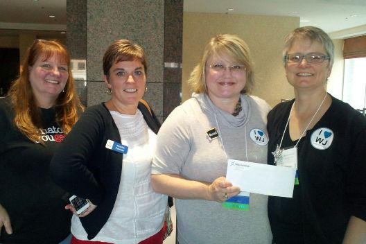[Photo: Jenniffer Stephenson, director, Greenwood-Leflore Public Library System (second from right) wins exhibitor grand pize with Jenny Powell, Jennifer Pearson and Jennifer Peterson]