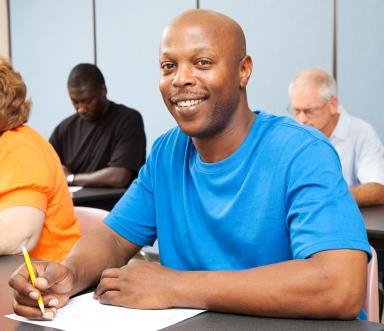 Smiling man working at a desk during a training