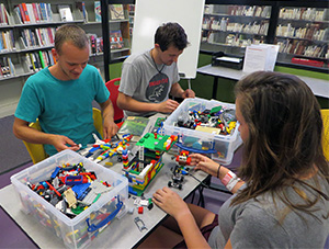 Photo of patrons playing with Lego in the library