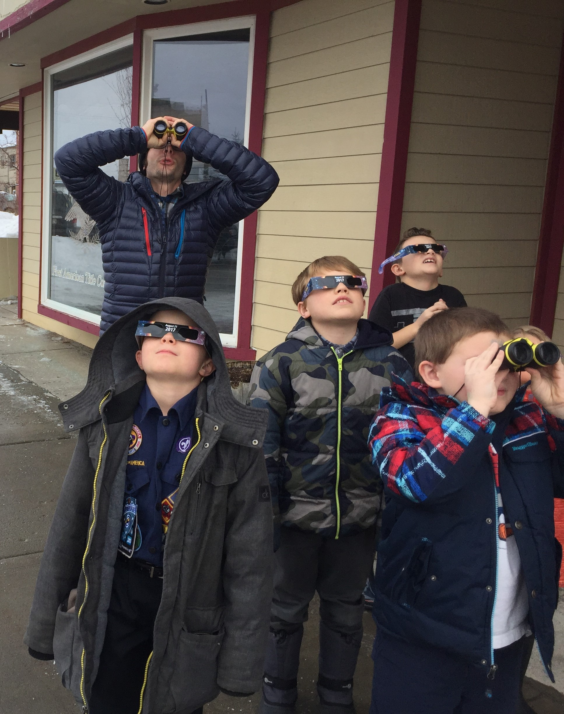 A Boy Scout Troop practices using safe solar viewing glasses and special binoculars in preparation for the solar eclipse. Image courtesy of Valley of the Tetons Library.
