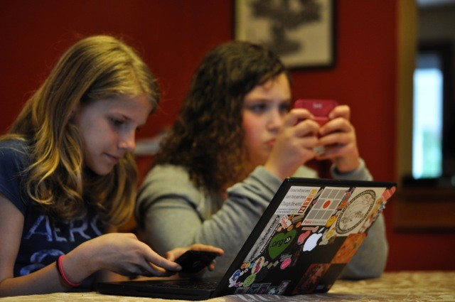 Girls using digital devices at home