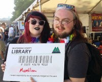 Patrons with giant library card at festival