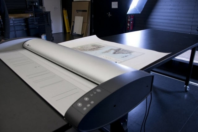 Photo of a map being scanned